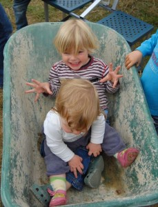 two-children-in-a-wheelbarrow