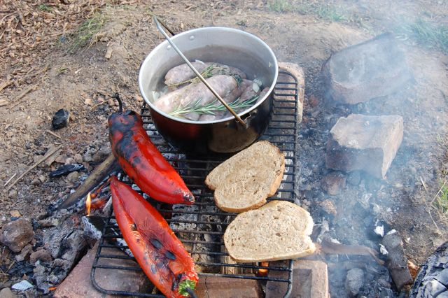 Sausage and wild garlic stew cooking on the campfire