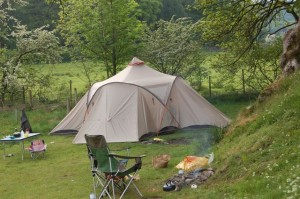 Vaude Badawi II tent pitched beside a campfire in the Lake District