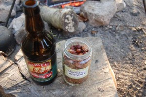 Harissa almonds with a bottle of beer beside the campfire