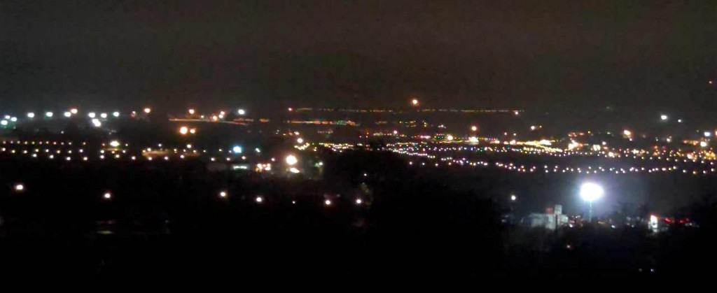 The lights of Glastonbury festival as seen at night