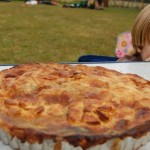 Festival pie on a table with a boy smiling