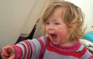 A toddler shouting No